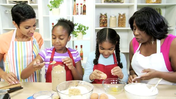 black women cooking with girls.jpg