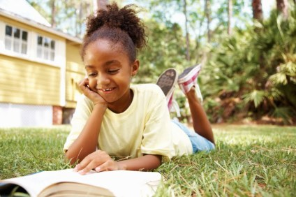 girl-reading-in-grass